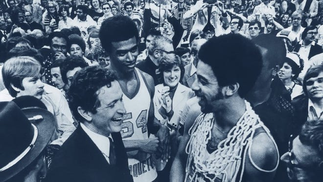 Coach Al McGuire, Jerome Whitehead and Bernard Toone (right) celebrate Marquette's only NCAA national title in 1977.