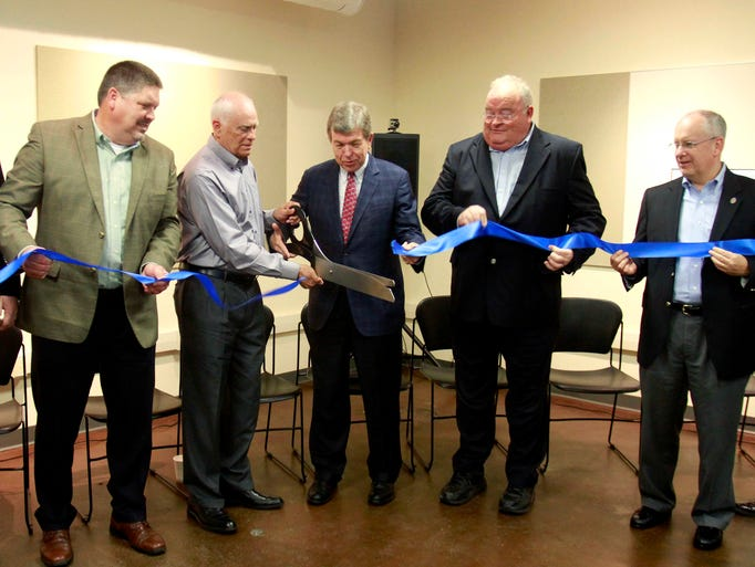 Terry Brewer (center left), president of Brewer Science, U.S. Sen. Roy Blunt (center right), and U.S. Rep. Billy Long help cut a ribbon celebrating an expansion of Brewer Science at the Roy Blunt Jordan Valley Innovation Center on Thursday.