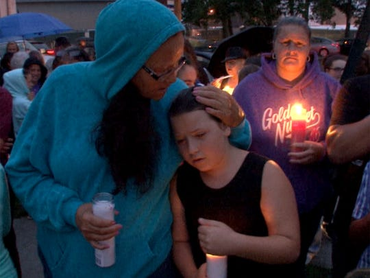 """People gather for a vigil in memory of AbbieGail """"Abbie"""" Smith, 11, Friday night,  July 14, 2017.  Smith was killed by a neighbor in her Keansburg apartment complex."""