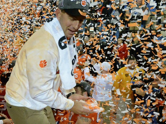 Clemson head coach Dabo Swinney and the team celebrate a 38-3 win over Miami after the game of the Dr.Pepper ACC football championship in Charlotte on Saturday.