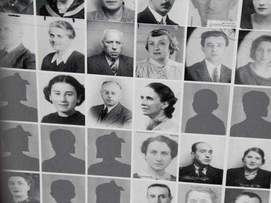 Photos of Fritz and Emmy Grunewald, center, and close to 20,000 other victims of the Nazis are displayed on a wall at the Kazerne Dossin museum and memorial center in Mechelen, Belgium.
