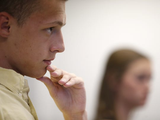 Denver Maddox listens to fellow students during the