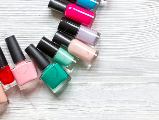 lot of bottles nail polish on wooden background top view