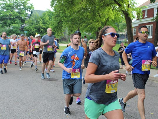 Runners take off for the start of the Cereal City Classic on Saturday, June 9, 2018.