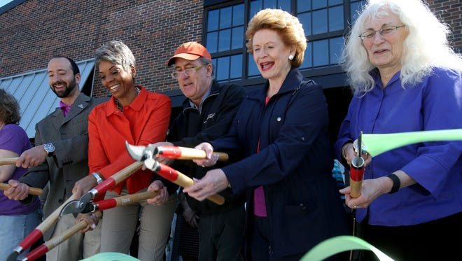 Detroit City Councilman Gabe Leland, left, Faye Nelson, Dan Carmody, president of Eastern Market Corp., U.S. Sen. Debbie Stabenow and Linda Jo Doctor of the  Kellogg foundation, officially open Shed 5 at Eastern Market on May 2, 2015.
