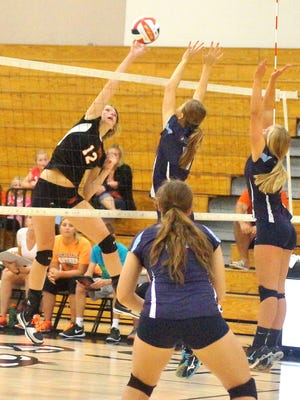 Shelby Coron of Oconto Falls goes up for the ball in a match with Little Chute on Sept. 3.