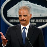 Attorney General Eric Holder  announces that a grand jury has charged five Chinese people with economic espionage and trade secret theft.