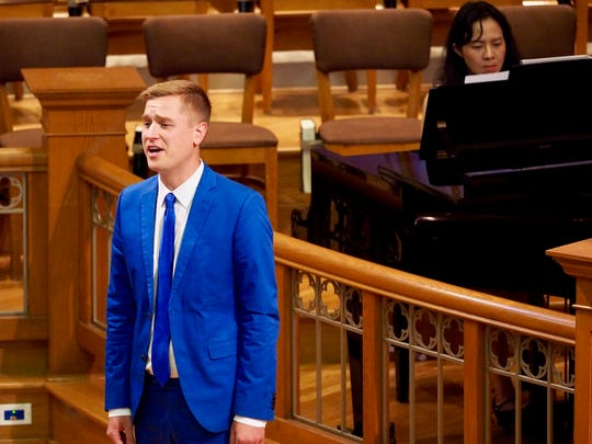 Mikah Meyer is taking a three-year, 100,000-mile journey to see all 417 National Park Service sites: Singing at Seattle First Baptist Church.