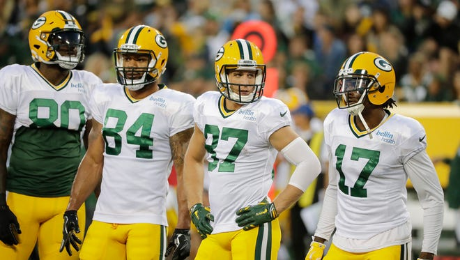 Green Bay Packers tight ends Martellus Bennett (80) and Lance Kendricks (84) and receivers Jordy Nelson (87) and Davante Adams (17) wait for the next drill at Packers Family Night on Saturday, Aug. 5, 2017, at Lambeau Field.