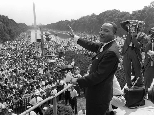 Martin Luther King Jr. waves to supporters from the