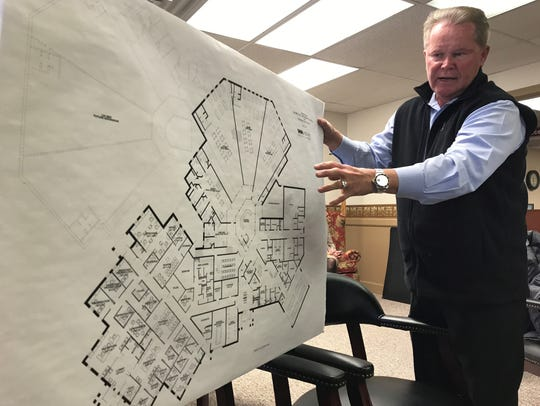 Garry McAnally, president of Wachtel and McAnally Architects, reviews a preliminary sketch for a possible new justice center with Coshocton County Commissioners in this Tribune file photo. On Monday, McAnally was asked to review two other possible sites for the jail to see how designs would be affected. Commissioners have long intended to place a new facility at the site of the former Central Elementary School when funding would become available.