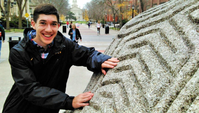 "Freshman Jack Moss of Bettendorf doesn't buck the mythical power of the ""Brain Rock"" on the University of Iowa campus."