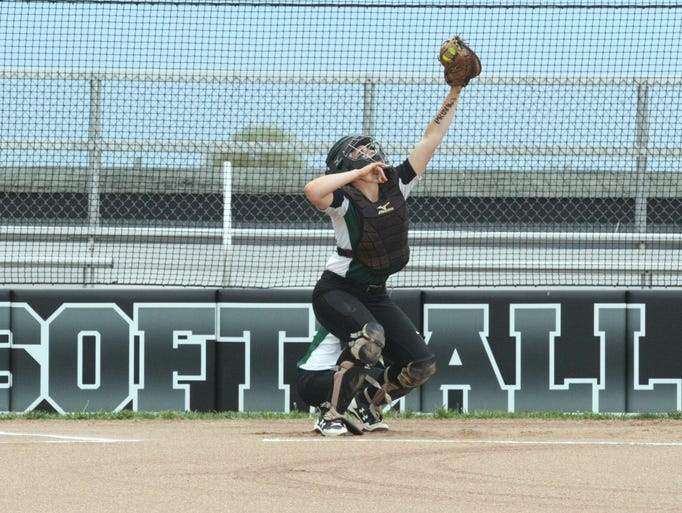 Mason catcher Brooke Rice warms up Elle Buffenbarger