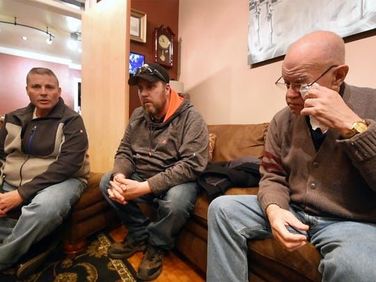 Edwin C. Rivera, right, becomes emotional when he talks about moving back into his home of 41 years. Steve Cottrill Sr, left, and Brandon Hershey Sr., center, of Budget Rentals LLC, talk about buying 481 Madison Ave. that was owned by Robert and Marlene Shomper since 1962.