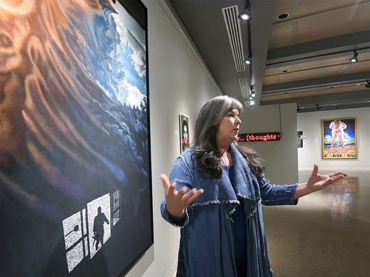 Kate Kretz talks about her exhibit COMMON DENOMINATOR at the Cora Miller Gallery at York College of Pennsylvania next to a a piece called 'Storm'