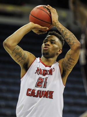 UL forward Shawn Long (21) attempts a free throw during the second half of a men's basketball game against Texas State in the Sun Belt Conference Championship tournament at the UNO Lakefront Arena in New Orleans on March 13.
