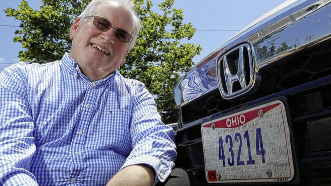 Paul Bingle has resigned from the Clintonville Area Commission, for which he held various positions since the early 1990s. Bingle is shown in front of his car, which has the ZIP code of the Clintonville area where he has resided since 1979. Bingle and his wife, Linda, are moving to Worthington until their home in Delaware County is completed.