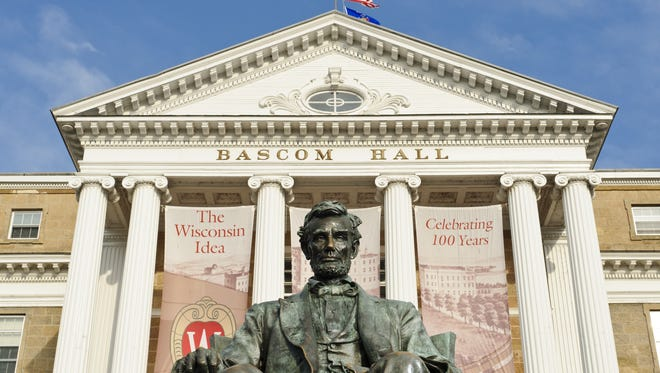 A statue of Abraham Lincoln sits in front of Bascom Hall atop Bascom Hill on the University of Wisconsin-Madison campus