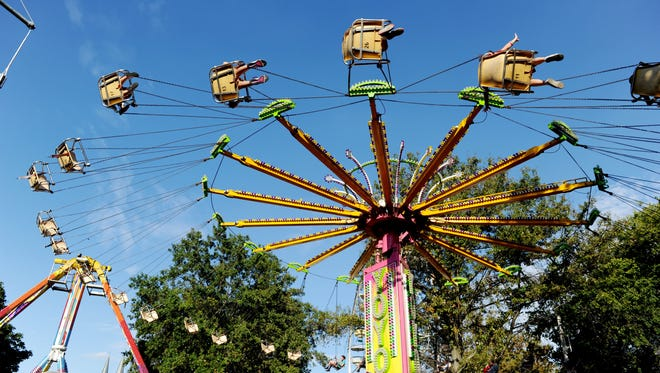 Festival goers enjoy one of the many rides during the West Side Nut Club Fall Festival last year.