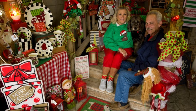 Audrey and Jerry Benton started Sweet Pea's Gift Shop about nine years ago, and their dog, Ellie, a Labradoodle, is the shop's mascot.