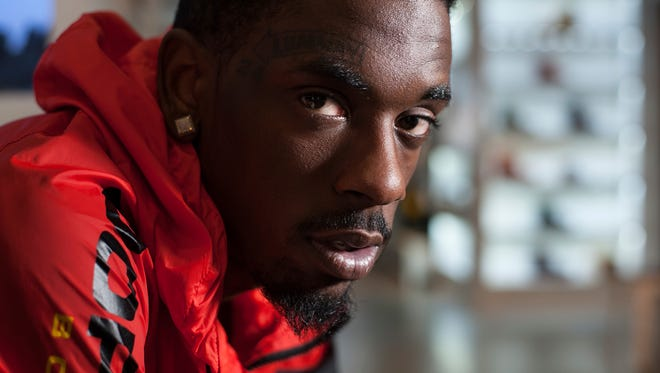 Up-and-coming hip-hop artist Jimmy Wopo, was shot and killed Monday in Pittsburgh when someone opened fire on his car, police said.