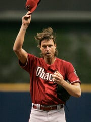 Diamondbacks Randy Johnson tips his cap after striking