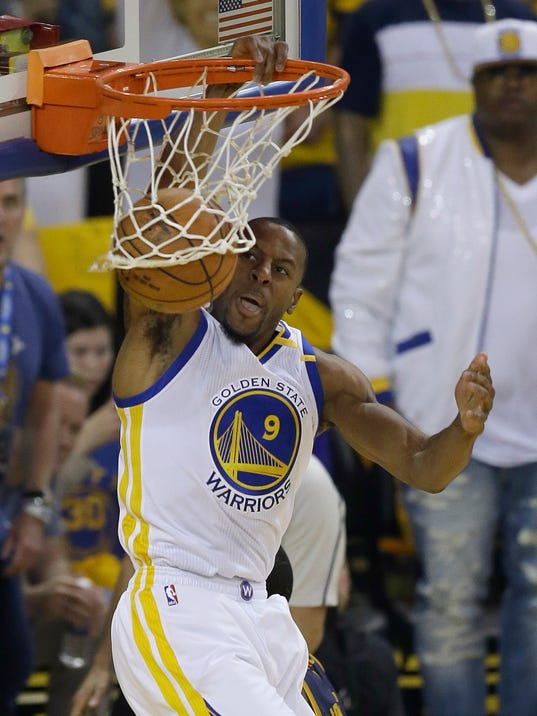FILE - In this June 1, 2017, file photo, Golden State Warriors forward Andre Iguodala (9) dunks against the Cleveland Cavaliers during the first half of Game 1 of basketball's NBA Finals in Oakland, Calif. Iguodala wants nothing of this conversation, not if it places any credit on him for anything _ he just wants to keep leading the championship Golden State Warriors, re-signing to stay as a key backup ready to chase another title. (AP Photo/Ben Margot, File)