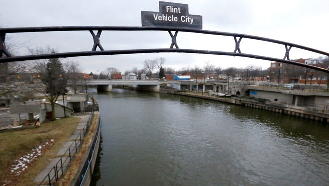 This  Flint River on Jan. 26.  Note the sign advertising Flint as Vehicle City.
