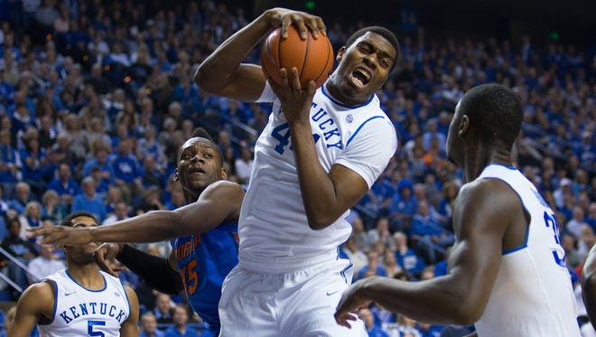 UK center Dakari Johnson grabs a defensive rebound in the first half. The University of Kentucky hosted Florida, Saturday, Feb. 15, 2014 at Rupp Arena in Lexington. Photo by Jonathan Palmer/Special to the Courier-Journal
