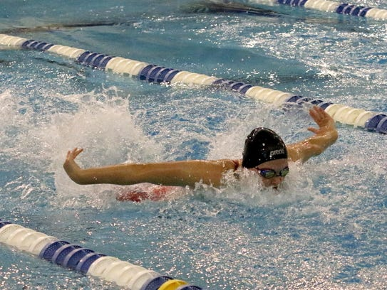 Summer Pierce of Owego swims in the 100 butterfly finals