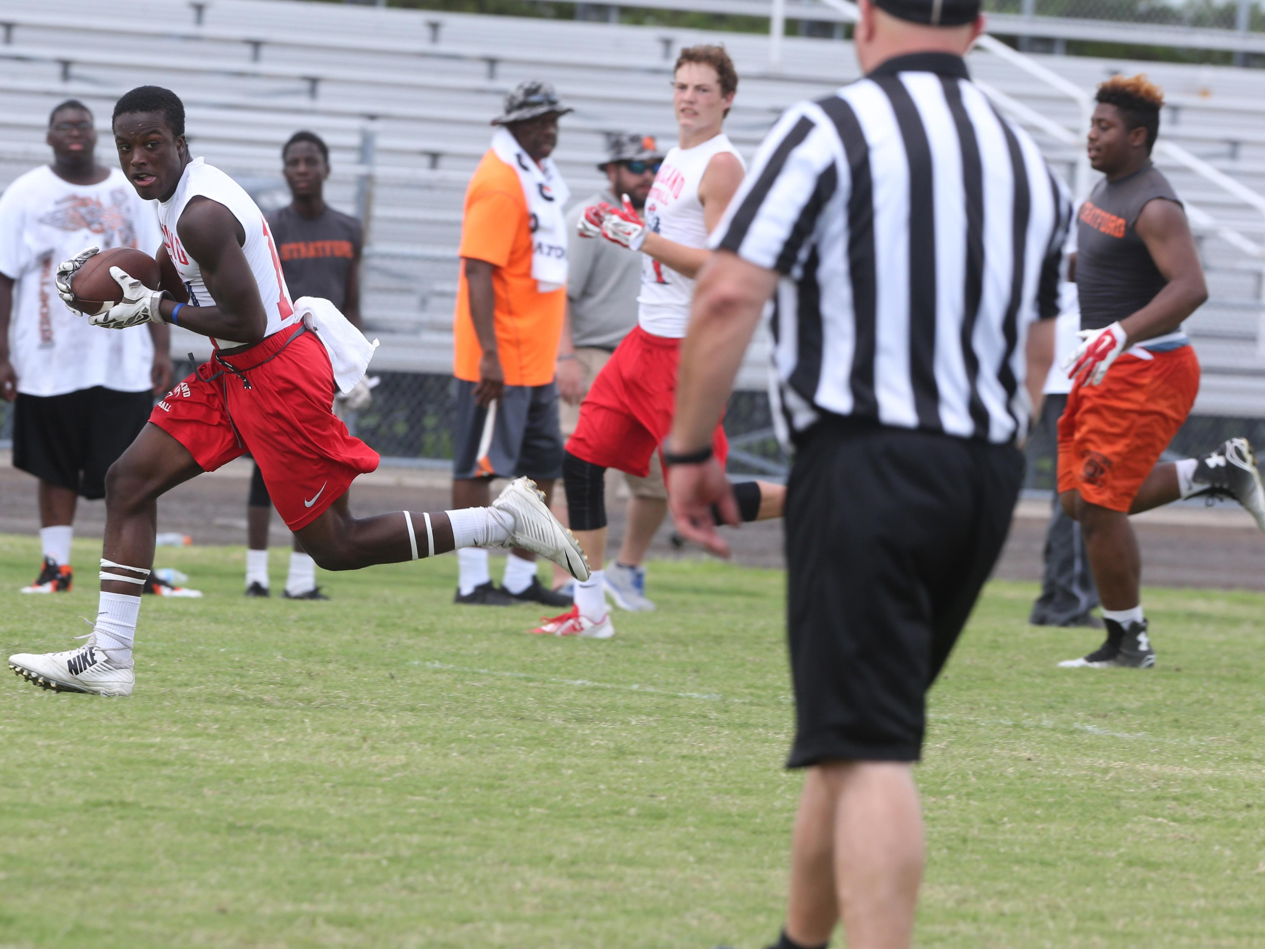 Oakland's Zarius Gamble pulls in a touchdown pass during a win over Stratford in Saturday's Ravenwood 7-on-7 Passing Tournament. Gamble reached the semfinals of the tournament.
