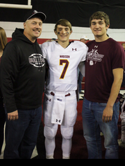 Josh Giles (middle) poses for a picture with Jacob (right) and their dad, Chris.