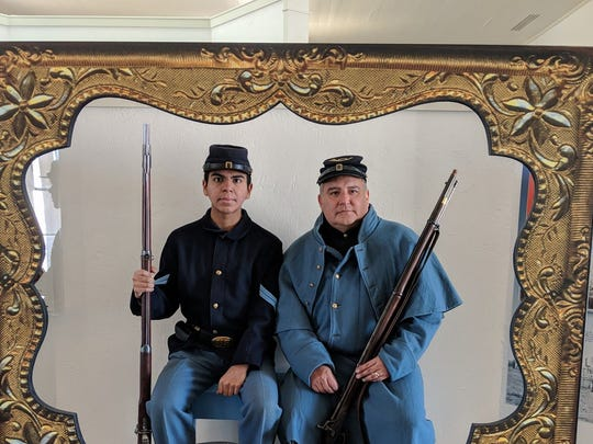 Daniel Garza,, left, and Edgar Garza have their photo taken inside the newly-refurbished visitors center at Fort McKavett State Historic Site on Jan. 13, 2017.