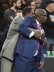 Detroit Mercy assistant coach Jermaine Jackson hugs
