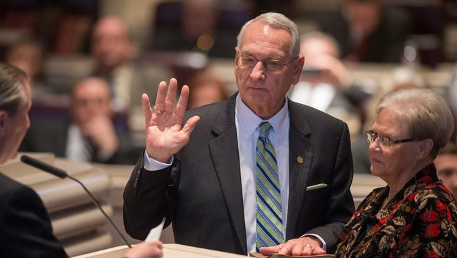Rep. Victor Gaston, R-Mobile, takes his oath of office after being elected Speaker Pro Tem of the House of Representatives during the Alabama House of Representatives organizational session on Tuesday, Jan. 13, 2015, at the house chambers in Montgomery, Ala.