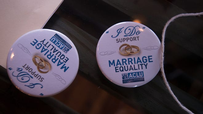 Buttons on an items table on Monday, Feb. 9, 2015, at KRU on Mt. Meigs in Montgomery, Ala., during a party hosted by the ACLU for same-sex marriage supporters
