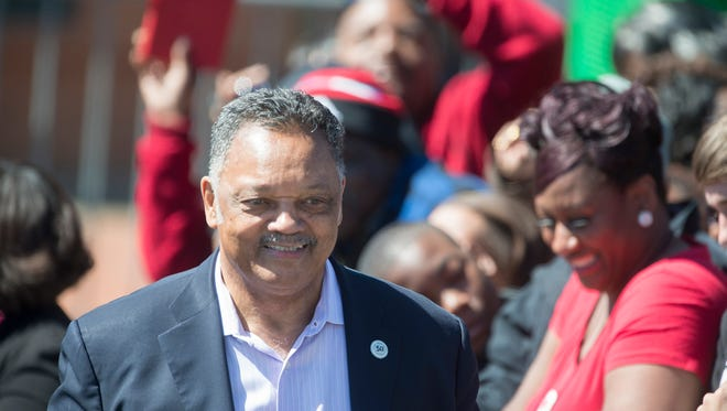 Jesse Jackson smiles while waiting for President Barack Obama's scheduled speech on the 50th anniversary of Bloody Sunday at the foot of the Edmund Pettus Bridge in Selma, Ala., on Saturday, March 7, 2015.