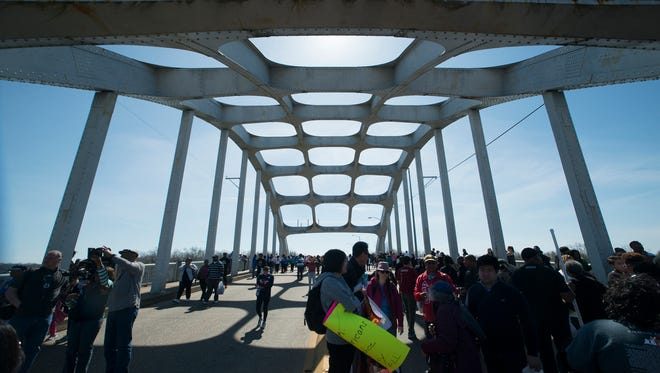 People gather on the Edmund Pettus Bridge in Selma, Ala., on Sunday, March 8, 2015, for a march to commemorate the 50th anniversary of Bloody Sunday.