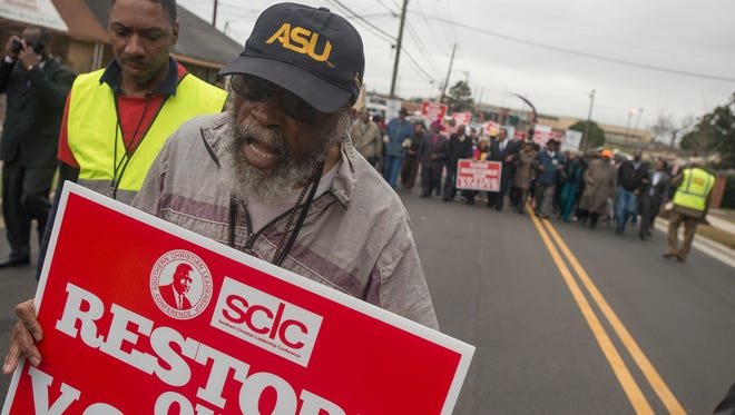 Fred D Taylor, who marched in 1965 during the Selma to Montgomery March, walks during the final day of marching of the SCLC March from Selma to Montgomery on Friday, March 13, 2015, in Montgomery, Ala. The march was organized by the Southern Christian Leadership Conference.