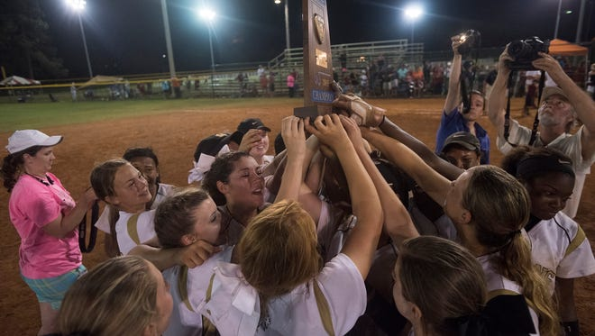 Wetumpka celebrates as they receive the trophy for the AHSAA Class 6A State Championship on Saturday, May 16, 2015, at Lagoon Park in Montgomery, Ala. Wetumpka defeated Southside-Gadsden 3-2 in a deciding game.