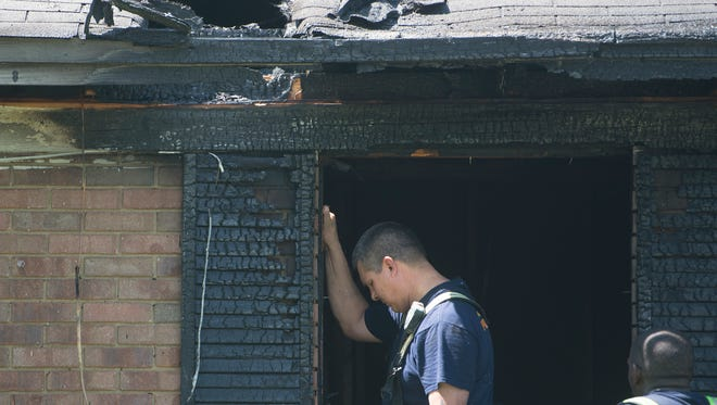 Montgomery Firefighters work the scene of a structure fires at  320 Greenleaf Drive in Montgomery, Ala., on Monday, June 22, 2015.
