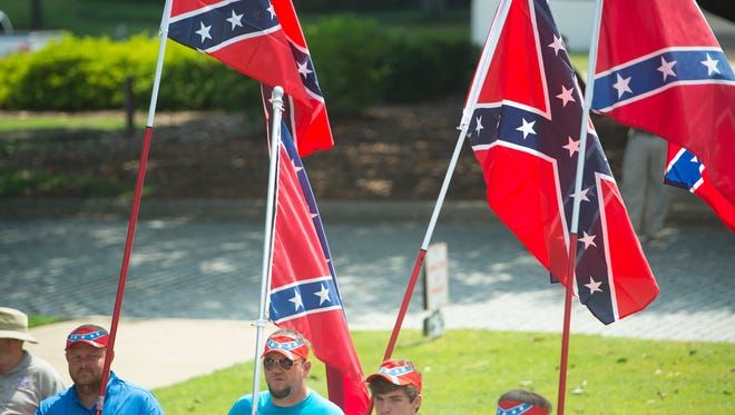 From left, Ottis Sparks, William Thompson, Brian Bragwell and Greg Kimbrough hold confederate flags at Alabama State Capitol building during a confederate flag rally on Saturday, June 27, 2015, in Montgomery, Ala.