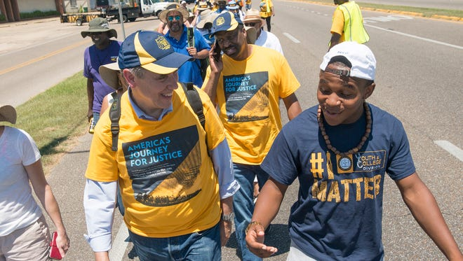 "Senator Jeff Merkley walks with DH Kyles, 18, during the start of the ""America's Journey for Justice March"" organized by the NAACP on Saturday, August 1, 2015, in Selma, Ala. The 860 mile relay march is planned to go from Selma to Washington D.C. over the course of 40 days."