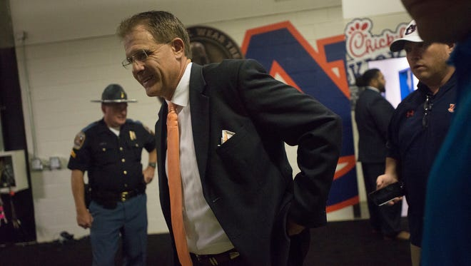 Auburn head coach Gus Malzahn stands outside the locker room before the NCAA football game between Auburn and Louisville on Saturday, Sept. 5, 2015, in at the Georgia Dome in Atlanta, Ga.