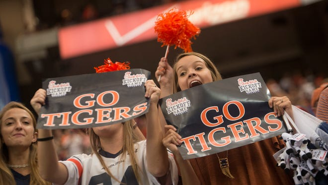 Auburn fans cheer during the NCAA football game between Auburn and Louisville on Saturday, Sept. 5, 2015, in at the Georgia Dome in Atlanta, Ga. Auburn defeated Louisville 31-24.