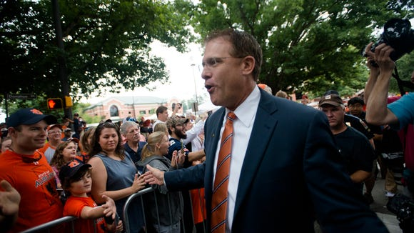 Auburn Tigers head coach Gus Malzahn greets fans during Tiger Walk before the NCAA Auburn vs. Jacksonville State on Saturday, Sept. 12, 2015, in at Jordan-Hare Stadium in Auburn, Ala.