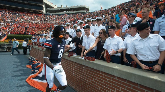 Auburn Tigers wide receiver Tony Stevens (8) celebrates with fans after Auburn defeated Jacksonville State Gamecocks 27-20 in overtime on Saturday, Sept. 12, 2015, in at Jordan-Hare Stadium in Auburn, Ala.Albert Cesare / Advertiser