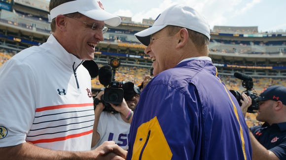 Auburn Tigers head coach Gus Malzahn greets LSU head coach Les Miles before the NCAA football game between LSU Tigers and Auburn on Saturday, Sept. 19, 2015, at Tiger Stadium in Baton Rouge, La. 