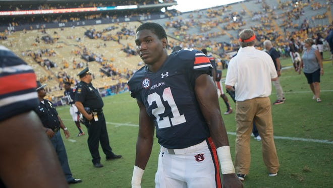 Auburn Tigers running back Kerryon Johnson (21) walks off the field after the NCAA football game between LSU Tigers and Auburn on Saturday, Sept. 19, 2015, at Tiger Stadium in Baton Rouge, La. LSU Tigers defeated Auburn Tigers 45-21.Albert Cesare / Advertiser