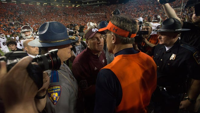 Mississippi State head coach Dan Mullen shakes Auburn head coach Gus Malzahn hand after Mississippi State Bulldogs defeated Auburn 17-9 on Saturday, Sept. 26, 2015, at Jordan-Hare Stadium in Auburn, Ala. 